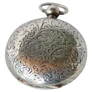 Edwardian silver sovereign holder with scroll foliage around a vacant shield.