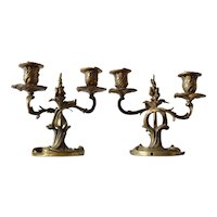 Pair of French bronze candlesticks by H. Voisenet, 1870-1892.