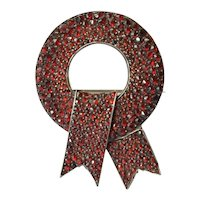 An early 20th century Bohemian garnet 'ribbon' pin brooch.