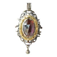 Silver ( 800 standard ) and silver gilt mounted garnet set pendant on chain, 1960 - 1980.