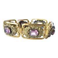 A gilt metal and glass 'amethyst' panel bracelet, revival piece, 1930c.