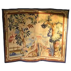 A Belgian hand woven tapestry panel depicting an exotic bird , early 20th century.