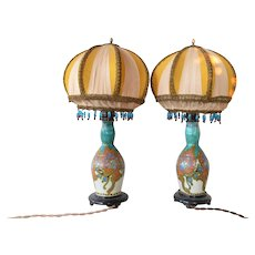 A pair of Plateelbakkerij Zuid-Holland, Gouda pottery Moorish pattern vases, 1923.