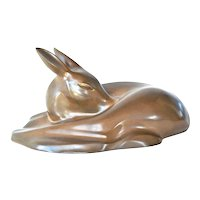 A Richard Fisher, patinated resin sleeping fawn, early vintage.