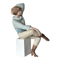 A late vintage Royal Dux, Bohemia  pastel figurine of a seated lady.
