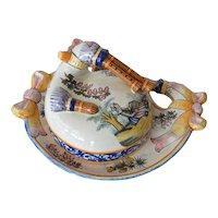 A Henriot Quimper covered faience dish, 'Biniou' ( bagpipe ) motif, 1940c.