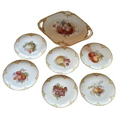 K.P.M. fruit bowl and six plates, 19th century.