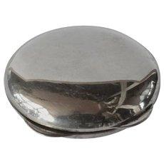 A silver ( 800 standard ) round pill box, 1930c.