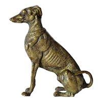A early vintage bronze seated greyhound dog figurine.