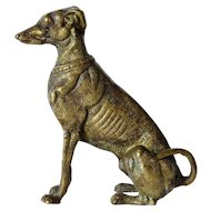 A early vintage bronze seated greyhound dog figurine.