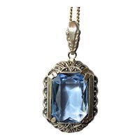 A pretty vintage silver (800) small pendant with blue paste stone and silver (925) chain.