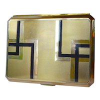 An art deco brass/enamelled cigar box 1930 - 1940.