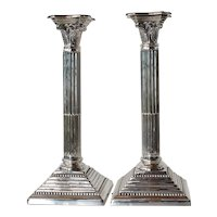 Pair of vintage ' white metal' candlesticks.