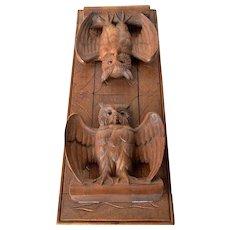 A hand carved oak Brienzer owl folding book rack , 1930c.