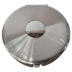 An art deco, silver ( 800 standard ) , round compact.