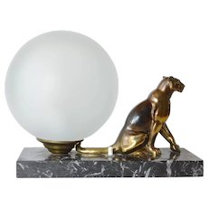 An art deco table lamp with gilded cat, 1930 - 1940.