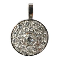 Vintage, white gold (18ct. ) diamond set round pendant, 1990c.