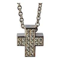 A vintage 18ct. white gold cross pendant with diamond set.