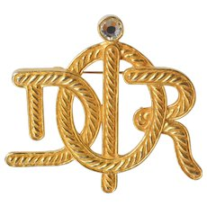 A Christian Dior vintage 'jewelled' gold tone insignia brooch, 1985c.