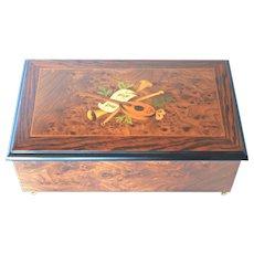 A vintage swiss Reuge walnut burr music/jewellery box.