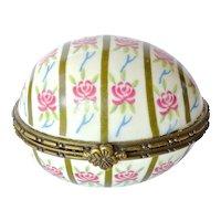 A vintage Limoges porcelain/metal hinged frame trinket/pill egg box.