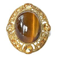 Tiger's eye and citrine set cluster ring in 9 ct gold; cabochon tiger's eye centre with facetted citrine surround, 1960 c.