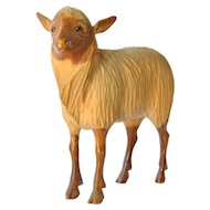 A Swiss hand carved sheep, early vintage.