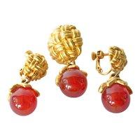 A vintage Kenzo of Paris brooch/earring set.