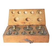 Early vintage boxed set of weights.