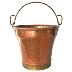 An antique copper/brass bucket.