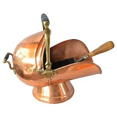 An antique copper/brass coal scuttle and shovel.