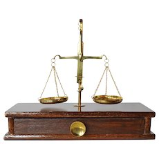 An early vintage wooden cased balance weight scale.