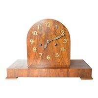 Late Art Deco era, mahogany desk clock, made by the Junghans Clock Company, Schramberg, in Wurtemberg, Germany, circa 1935.
