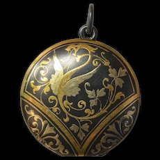A round metal , early 1900s, pendant.