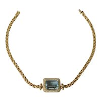 An 18ct. Gold Aquamarine & Diamond Necklet, circa 1980.