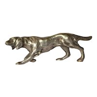 An early vintage silver ( 800 standard ) shooting dog.