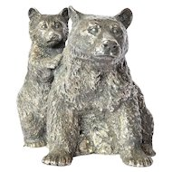 A ' metal' sculpture of a mother bear and her cub.