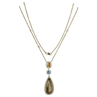 18ct Gold Pendant on chain set with oval cut gem citrine,1970c.