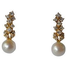 Pair of gold ( 18 ct. ) diamond and pearl set drop earrings by C. Bucherer, Switzerland, 1970c.