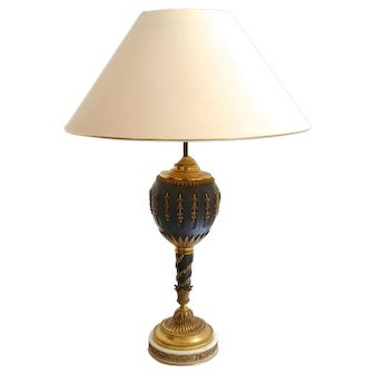 """A gilt-bronze and bronzed lamp, """"Luminator Francais"""" by UNIS FRANCE, 1925c."""