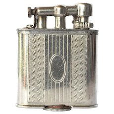 Cigarette lighter, early vintage, lift arm.