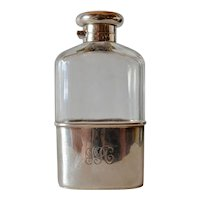 A George V sterling silver mounted glass spirits flask, maker's mark , London, 1913.