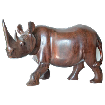 Rhinoceros, hand carved from African hard wood, mid 20th century.
