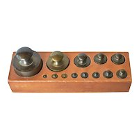 Set ( 13 )of  continental brass scale weights, mid 20th. century.