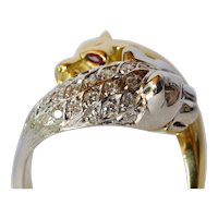 A two-colour Gold (  18 ct. ) panther cocktail head Ring, 1980-1985.