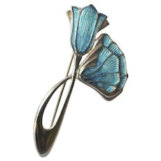 Art deco silver and enamelled blue flower brooch, 1930 .