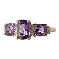 Vintage gold (9ct.) amethyst trilogy ring with diamond set.