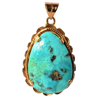 A vintage gold ( 18 ct. ) mounted turquoise pendant.