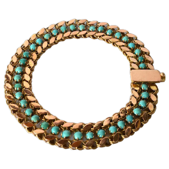 Gold ( 14 ct. ) bracelet with turquoise cabochons, 1980c.
