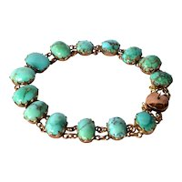 Gold ( 14 ct. ) link bracelet with turquoise cabochons, late 19th/early 20th century.